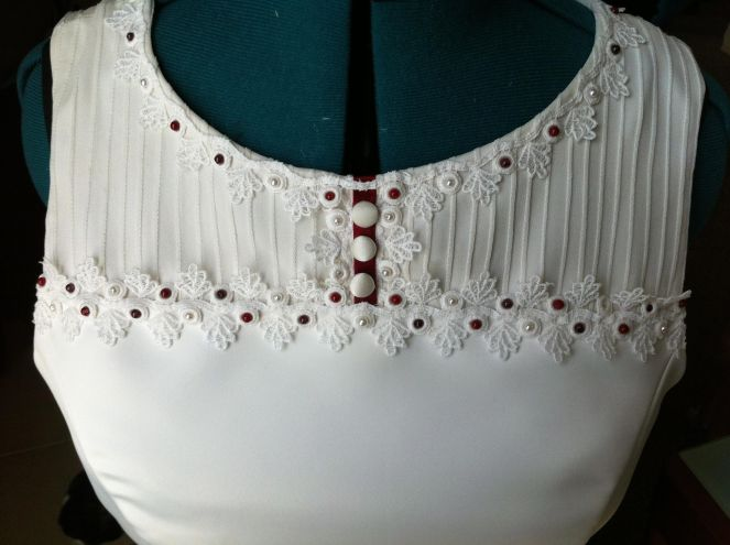 Detail of the front with beading and lace